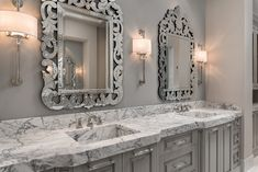 The Howard Elliott Regina Mirror is shown here in a bathroom designed by Fratantoni Lifestyles in Arizona. The frame itself is fashioned in the Venetian style of an ornate scrolling design which we accentuated by finishing it with mirrored glass. Each piece of the frame is is beautifully etched. It is a perfect focal point for an entryway, bathroom, bedroom or any room in your home. #bathroommirror #howardelliottmirror #ornatemirror