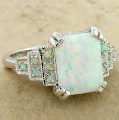 Lovely White Opal Art Deco Ring - I love the idea of opals instead of diamonds, at least for the center stone by Khandiie
