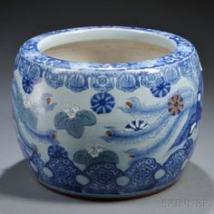 Blue and White Porcelain Hibachi, Japan, 20th century, round jar with flat mouth rim, the body decorated with a phoenix, the rim embellished with floral and foliate motifs, the base defined by two bands of fret patterns and of brown