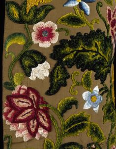 Embroidery detail: Waistcoat, England, Britain (made) 1735-1745 (made) Silk, silk thread, hand-sewn and hand-embroidered. On this waistcoat, the chenille threads graduate in shade from light to dark green on the leaves and white through pink to dark red on the flowers, giving each a three-dimensional quality. The arrangement of the embroidery covering the whole of the waistcoat and the large scale of the pattern are typical of Baroque design. VandA