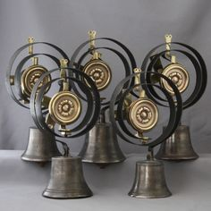A beautiful and great set of 5 domestic call bells all with graduated tones. The brass flower decorations are a quite unusual design. http://www.architecturaldecor.co.uk/collections/servants-bells-fittings