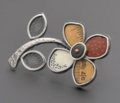 """Kristi Zevenbergen  Flower pin/pendant in sterling silver, ivory, ruler fragment, and polymer clay. 3 x 2"""""""