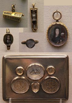 """""""Memento Mori"""" coffin pendants 16c, Stuart memorial jewellery 1660-1714 Charles I's miniature portrait, Charles II memorial rings 1684, Silver box with memorial jewels-- Five of the jewels with monograms in gold wire; one with a skeleton and MEM.MOR (memento mori: remember that you must die). The memorials late 17th or early 18th c, set in an 18th-century box.  British Museum"""
