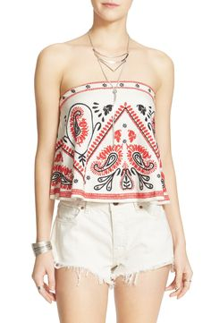 This free-spirited look pairs a strapless embroidered top with white shorts for a boho vibe.