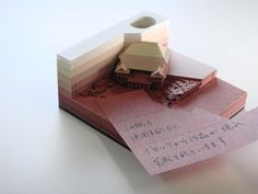 Leave it to the stationery-loving Japanese to come up with a new way to enjoy writing notes. The Omoshiroi Block (loosely translated as 'fun' or 'interesting' block) utilizes laser-cutting technology to create what is, at first, just a seemingly normal square cube of paper note cards. But as the not