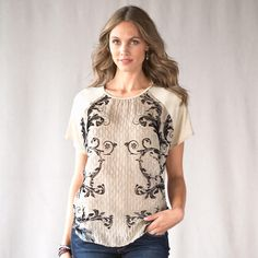 "TUILERIES TEE -- Posh and palatial, this rayon knit top boasts a burnout silk front, spectacularly scrolled. Raglan sleeves, high-low hem. Silk/rayon. Dry clean. Imported. Sizes XS (2), S (4 to 6), M (8 to 10), L (12 to 14). Approx. 26""L."