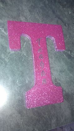 Wooden letter from Michael's and scrapbook glitter paper with mod podge glittered sides. Then letter stickers for the name.