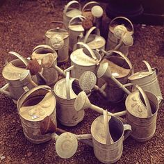 watering cans.....another passion of mine that I love to collect!