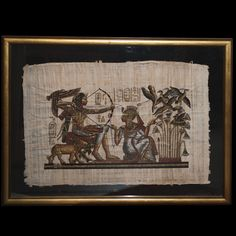 """DESCRIPTION:Egyptian hieroglyphic art on papyrus. Illustrates a regal figure with a bow hunting birds nestling above reeds with a small lion by their side. Finished with Egyptian hieroglyphs and in a glass and dore wood frame. CIRCA:20th Ct. ORIGIN:Egypt DIMENSIONS:H:35"""" L:46"""""""