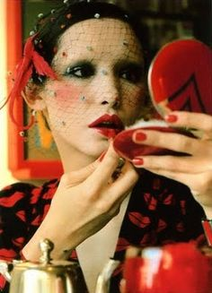 Cathy Dahmen in a spotted veil and lots of 70s makeup