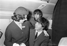 The Beatles July 1964 Paul McCartney has an air stewardess sitting on his knees on board the plane bound for Liverpool They were going to attend the premiere of A Hard Day's Night.