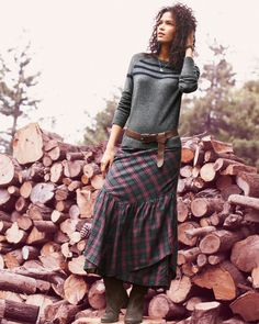 Sweater with belt on a long skirt