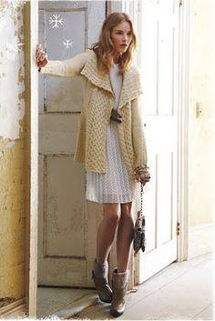 cream colored sweater and a cute white dress.