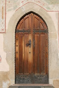 Beautiful traditional wooden door can be seen here with metal patterns all around the door. I love the colour of the door in combination with the colour of the metal. I will definitely look into this idea