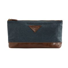 MOZI's Gentleman's Collection Toiletry Bag is made from indigo cotton chambray with dark tan PU leather with polyester lining, & is finished with a stylish brass zipper.