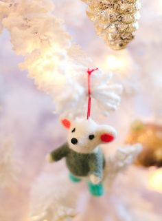 Add woodland whimsy to a flocked Christmas tree.
