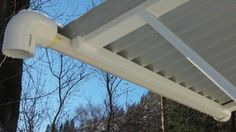 Using a PVC pipe on a metal roof as a gutter. Dead easy and very low maintenance!