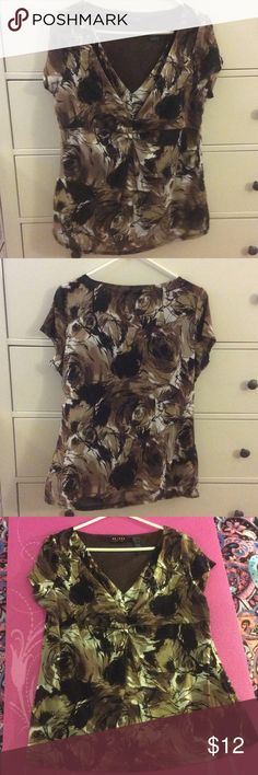 Sophisticated Top  Empire Waist. Cut to flatter. Great Condition. Shell is 100% Nylon. Lining is 100% Polyester. Lightweight. Feminine. Liz Claiborne Tops Blouses