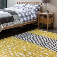 The Aliyah large yellow and charcoal wool hand-tufted rug is a gun-tufted design that is hand carved by craftsmen, creating a striking, sculptural effect. Made from wool, the soft rug feels fabulous underfoot and its pretty pattern and palette mak Hand Tufted Rugs, Pretty Patterns, Soft Furnishings, Wool Rug, Craftsman, Hand Carved, Pattern Design, Charcoal, Bedroom