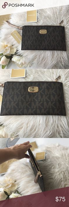 Michael Kors Wristlet/Clutch Brand new with tags beautiful Michael Kors Wristlet/ Clutch. Brown pebble leather with brown MK monogram print. Gold zipper closure and contrasting tan leash. Interior has multiple storage spaces including credit card slots. Michael Kors Bags Clutches & Wristlets