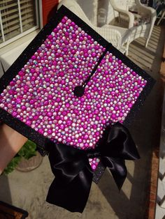 DIY sparkly graduation cap decoration that everyone will see! Just buy sparkly scrapbook paper and glue on rhinestones and bow with crafting glue.