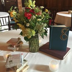 in Bloom #centerpiece #floralarrangement and book-themed decor at #thebarns #ctweddinggroup #powerstationevents #inbloomfloral