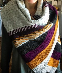 Knitting Pattern for Om Shawl - This versatile shawl with texture and colorwork can also be worn as a poncho, stole, cowl or used as a lap blanket. Designed by Andrea Mowry. Pictured project by pialuna111