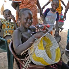 Woven Baskets   African Products from Swahili Modern.. this girl is sooo pretty!