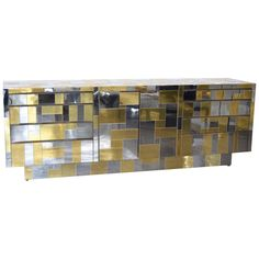 Cityscape Cabinet in Chrome and Brass by Paul Evans | From a unique collection of antique and modern cabinets at https://www.1stdibs.com/furniture/storage-case-pieces/cabinets/