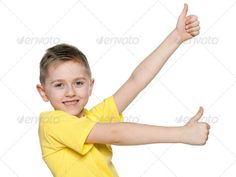 Young boy with his thumbs up ...  alone, boy, caucasian, cheerful, child, childhood, confident, cut out, cute, enjoyment, european, fashion, fun, gesture, handsome, happiness, happy, indoor, isolated, joy, kid, one, people, person, pleasure, portrait, positive, positivity, profile, shirt, side, single, smile, stand, studio, thumb up, thumbs, thumbs up, white, yellow, young