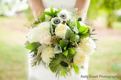 The Perfect Garden Bouquet | Artistically designed #bridalbouquet of pale #yellow #gardenroses, #white garden #roses, pale #pink #roses, pale #yellow #dahlia, white #anemones, scabiosa pods, brunia berries, blue thistle, dusty miller, seeded eucalyptus and mixed greens. #weddingarrangements #weddingflowers