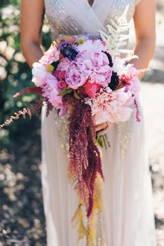 Soft pinks, burgundies, and yellow billy balls give this bouquet a unique palette.