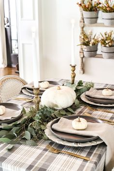 A neutral low-key Thanksgiving tablescape that is simple and inexpensive to recreate using plaid fabric, white pumpkins, eucalyptus, and brass. Thanksgiving Table Settings, Thanksgiving Parties, Thanksgiving Tablescapes, Thanksgiving Decorations, Seasonal Decor, Table Decorations, Outdoor Thanksgiving, Holiday Tablescape, Thanksgiving Crafts