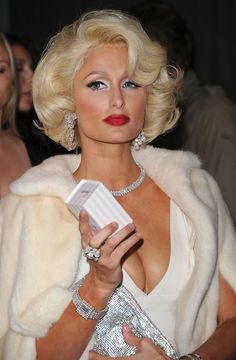 Oh, I know, it's laughable. It makes her look ancient. But there was a time, this was THE look. Not just Marilyn, but I assume that's who she is channeling.
