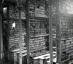 A man taking a book off the shelf in Cincinnati main library in 1874. Photo by: Public Library of Cincinnati and Hamilton County.