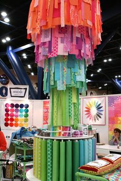 Awesome fabric strip chandelier in the Michael Miller booth at Quilt Market 2012 - wrapup post from TrueUp