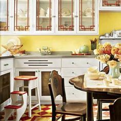 Yellow kitchen with red and yellow diamond-check floor.