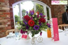 One of the colourful table centres designed for the reception