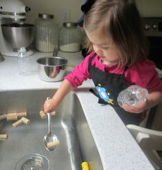 playing with water for toddlers, put corks in water and let them fish the corks