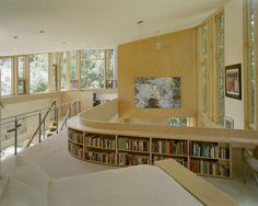 Love the wrap around book shelf and all the windows.