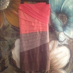 SALE Rousing cocktail dress Worn once. Perfect condition. Shows off all the curves in the right places. Colors are pink coral and chocolate brown. Will fit 6/8 Jodi Kristopher Dresses