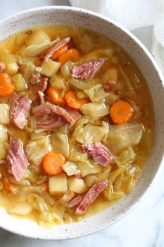 If you're making a big bone-in ham for the holidays this year, don't throw away the leftover ham bone once all the meat's been cut off. It's a key ingredient in this soup that adds instant flavor with minimal effort! Here I added some vegetables, potatoes Ham And Cabbage Soup, Cabbage Soup Recipes, Ham Soup, Healthy Soup Recipes, Vegetarian Recipes, Cooking Recipes, Chicken Soup, Recipes With Ham Bone, Ham Bone Potato Soup