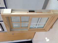 """Ply Gem wood clad double hung window with 7/8"""" simulated divided lite grids on top sash and 5/8"""" flat grilles between the glass on bottom sash, with white hardware, unfinished pine wood interior."""