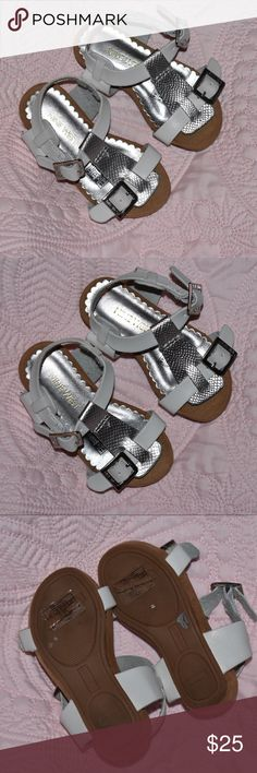 Nine West Toddler Sandals size 5 Perfect Condition Nine West Toddler Sandals size 5 Perfect Condition. My daughter was wearing a size 5, but these were small on her. She wore them for about 15 minutes before we decided they were too small. Adorable shoes! No scuffs or marks. Measures 5 1/4 from heel to toe. Nine West Shoes Sandals & Flip Flops