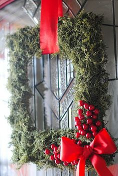 This was made using a large frame and reindeer moss. It's given me the idea to use small Dollar Store frames and make smaller wreaths to hang in my kitchen windows this Christmas.