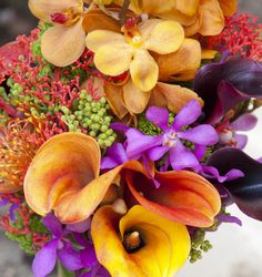 This tropical inspired bouquet would make the most stunning centerpiece. Structured callas with whimsical coral accents