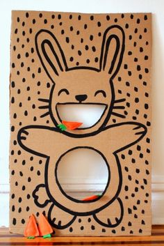 Hungry Bunny Toss – Switch up the age-old bean bag toss for this silly bunny version. Instead of bean bags, hot glue two orange felt triangles, fill the little pouch with lentils, and seal with a leafy green detail. Instant batch of carrots for tossing! Click through to see the whole gallery and for more easter games.
