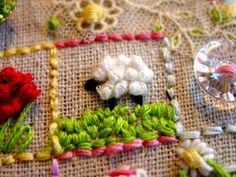 closeup on embroidered sampler