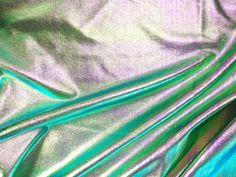 Metallic stretch denim fabric in stock at Pine Crest Fabrics. 70% poly 25% Nylon 5% Spandex. 4 way stretch. Call now for yardage 800-877-6487.