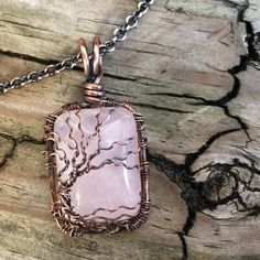 Small Rectangle Rose Quartz Antique Copper Wire Wrapped Bare Winter Tree of Life Pendant Handcrafted by Ann White.  This pendant is small and hangs 1 1/4 inches from the top of the bail and is 11/16 i